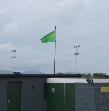Caernarfon Town Football Club, The Oval, flies the Caernarfonshire county flag 2012
