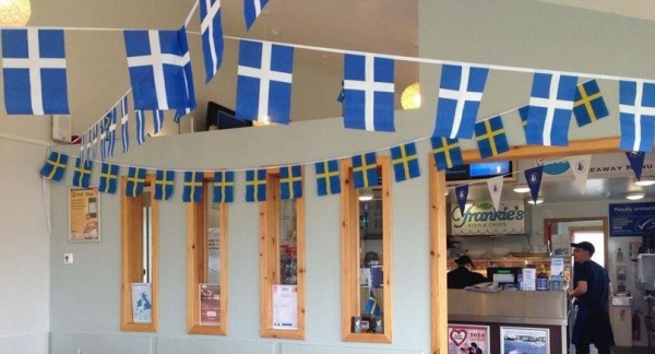 In recogntion of their shared Nordic heritage, a Shetland restaurant is decorated with Shetland and Swedish flags on the latter's national day..jpg