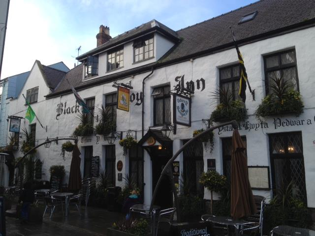 The Black Boy Inn in Caernarfon - the first place to fly the Caernarfonshire flag, Wales flag and the flag of St. David side by side.