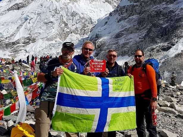 Paul Hooper, far left, and his friends with the Gloucestershire flag at Everest base camp.jpg