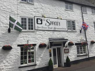 The Devon flag in Bampton, from Brady Ells.