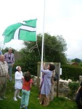 The flag of Devon raised over Landscove village in the county.