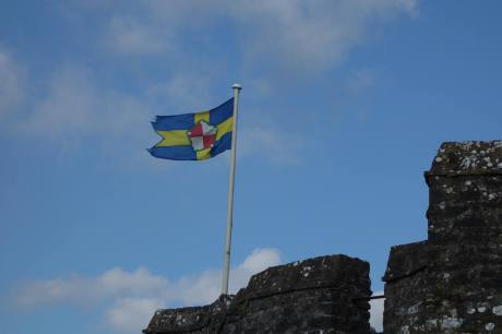 The flag of Pembrokeshire over Pembroke Castle from Leigh Cotteril.