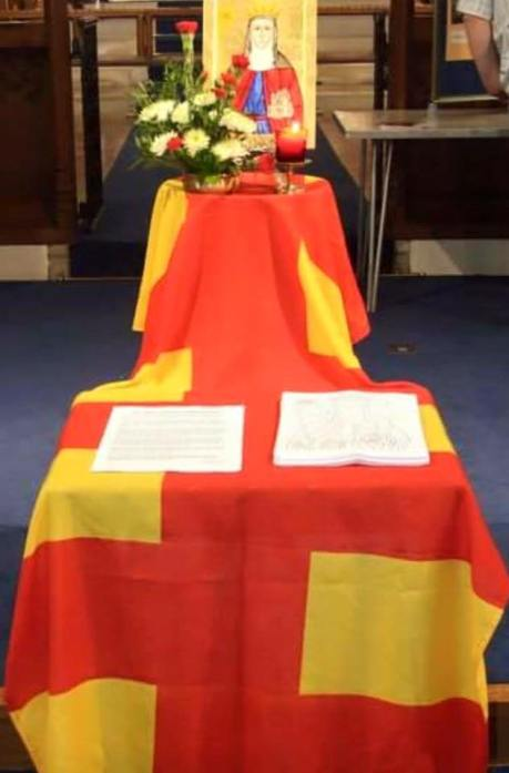 The Northumberland flag decorates a display in a church.