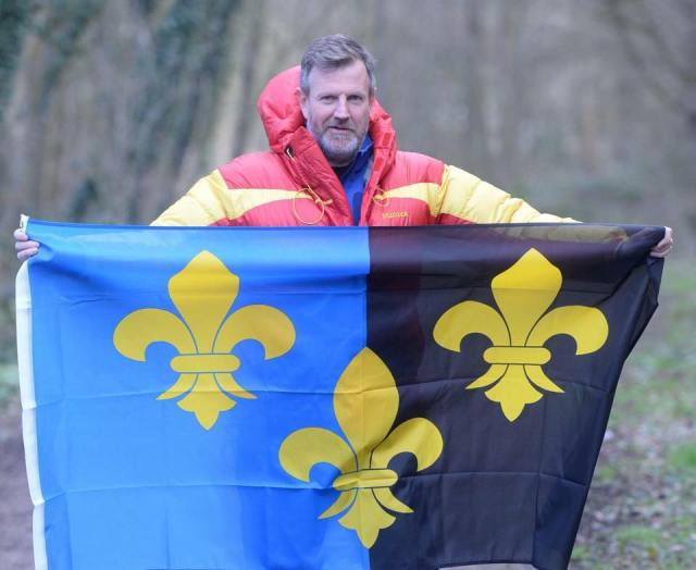 Local businessman Paul Fosh who took along his county flag when he set out on an Arctic trek for charity.jpg