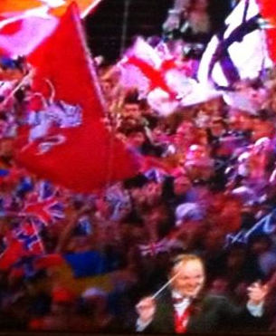The flag of Kent wielded at the Proms, amongst a sea of flags.- 2014