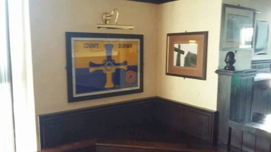 A County Durham flag made of glass! On display in the Wheatsheaf Public House in Chilton, County Durham.