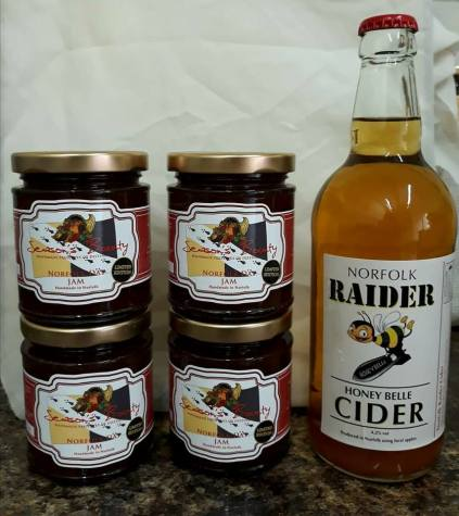 Norfolk county flag (and bumblebee!) on a selection of Norfolk jams and cider.