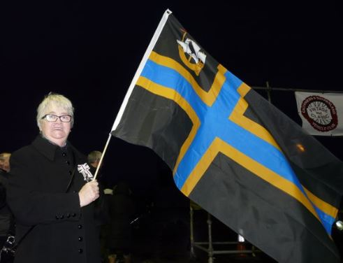 Lord-Lieutenant Anne Dunnett waving off Rallye Monte Carlo Classique at John O_Groats with new #Caithness flag. 27-1-2016