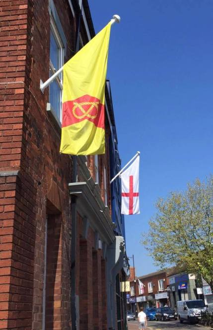 A vertical banner version of the Staffordshire flag in Market St, Hednesford.