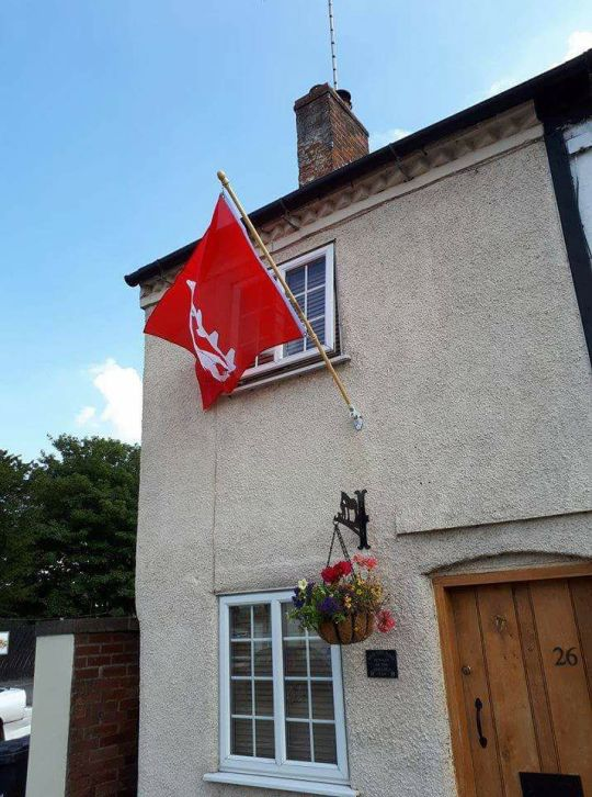 The county flag of Warwickshire displayed at the front of an attractive cottage in the county!