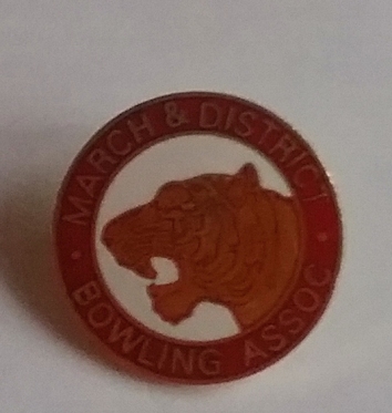 the Fen Tiger on the badge of the president of the March and District Bowling Association