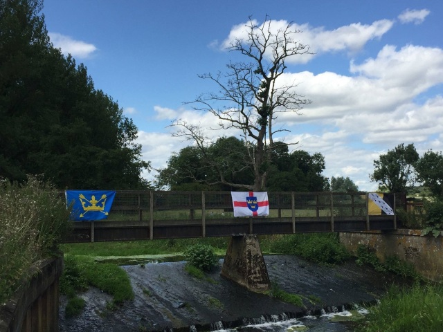 Looking west over the River Waveney, , marked by respective county flags and the flag of East Anglia in the centre..jpg