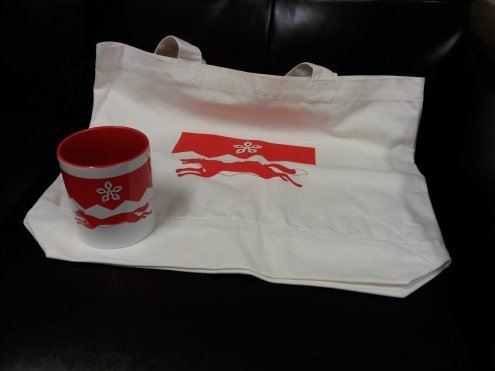 A tote bag and mug bearing the Leicestershire Fox and Cinquefoil.