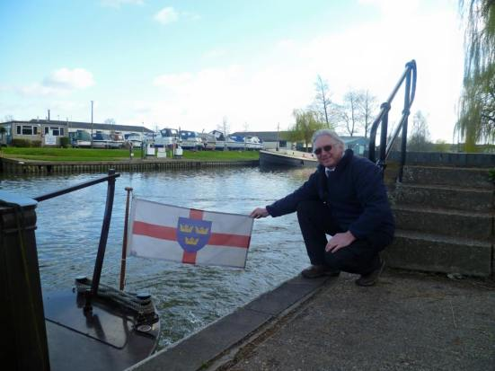 Bob, owner of River Ely cruising vessel, the Liberty Bell, with the flag of East Anglia which he flies on the boat.