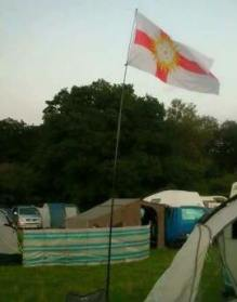 The flag of the West Riding of Yorkshire flies at Busfest - a gathering of VW van enthusiasts.
